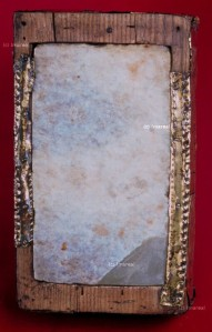 white marble altar stone set in wood frame with copper