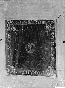 black and white photo of altar stone in wood