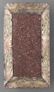 Red porphyry altar stone in frame of silver